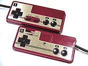 Famicom controllers were simple in design, though they included a number of features, such as a microphone, missing from their NES counterparts. Notice that the 2nd controler does not have Start and Select buttons, but instead, a microphone.