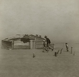 Dust Bowl - A farmer and his two sons during a dust storm in Cimarron County, Oklahoma, April 1936. Iconic photo taken by Arthur Rothstein.