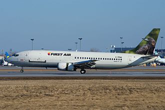 Combi aircraft - Boeing 737-400 combi aircraft of First Air with passenger windows behind the wing but not ahead