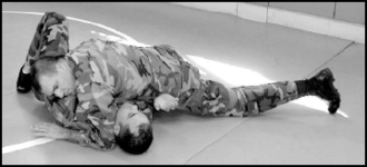 Grappling position - Side control as shown in a combatives manual.