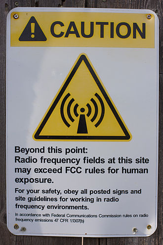 Electromagnetic radiation and health - Warning sign next to a transmitter with high field strengths