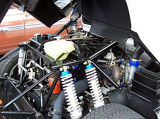 Cosworth - 1803 cc BDT on Ford RS200 with turbocharger and wastegate valve more visible than the engine