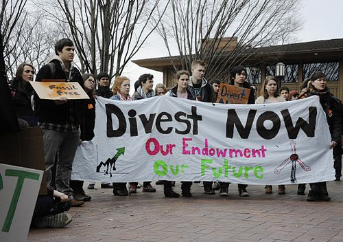 "Students at Tufts University ""marched forth on 4 March"" coinciding with dozens of student-led rallies around the United States. The marches had the objective of pressuring universities to eliminate investments in fossil-fuel related ventures. Fossil Fuel Divestment Student Protest at Tufts University.jpg"