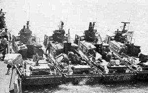 Four Swift Boats in Vietnam, showing rear .50 caliber (12.7 mm) machine gun and grenade launcher mount.