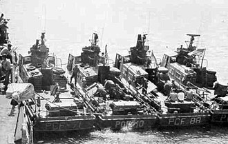 Patrol Craft Fast - Four Swift Boats in Vietnam, showing rear mounted over/under .50 caliber (12.7 mm) machine gun and breech-loading mortar