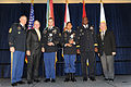 From left, Sergeant Major of the Army Raymond F. Chandler III, Retired Sergeant Major of the Army Jack L. Tilley, Staff Sgt. Matthew Senna, Noncommissioned Officer of the Year winner, Sgt. Saral Shretha, Soldier 121022-A-TC661-087.jpg
