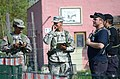 From left, U.S. Army Spc. Ayanno Davis and Staff Sgt. Hector Gonzalez, with the 525th Battlefield Surveillance Brigade (BfSB), talk with Soldiers assigned to the 1st Battalion, 4th Infantry Regiment as they act 130506-A-DI345-005.jpg