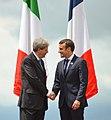 G7 Taormina Paolo Gentiloni Emmanuel Macron handshake 2017-05-26 (cropped).jpg