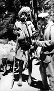 Gaddi village men with hookah, on mountain path, 1980.jpg