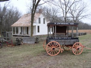 George Washington Carver National Monument - Wagon and 1881 Moses Carver House at George Washington Carver National Monument