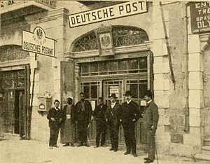 Postage stamps and postal history of Palestine - Post office personnel standing outside the German Post Office in Jerusalem. 1921