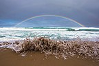 Gibson Steps rainbow and wave Great Ocean Road.jpg