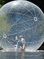 Girl in Bubble - City Park - Brest - Belarus (26873159033).jpg