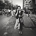 Girl on the phone, Dhaka (36212914350).jpg