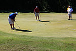 Golfers help send Marine children to school 121021-M-EG384-039.jpg