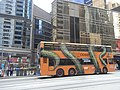 HK Sheung Wan Des Voeux Road bus body ads Now Cable TV 金龍中心 Golden Centre April-2011.JPG