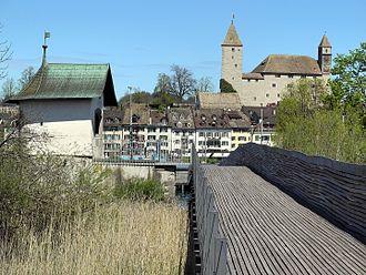 Heilig Hüsli - Holzbrücke Rapperswil-Hurden, Seedamm to the left, Heilig Hüsli and Rapperswil respectively Rapperswil Castle and Lindenhof hill in the background