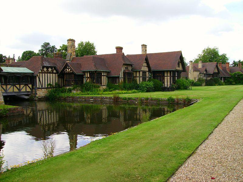 File:Hever Castle cottages near moat.JPG