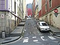 Hilly street with sidewalk steps (18621088280).jpg