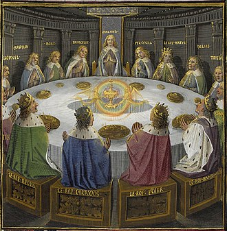 "Caradoc - ""King Carados"" (in blue at front) sits at the Round Table during the appearance of the Holy Grail in a 15th-century miniature."