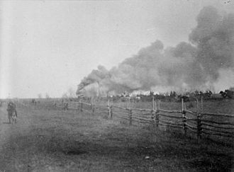 Battle of Batoche - A house in Batoche in flames during the opening stages of the battle.