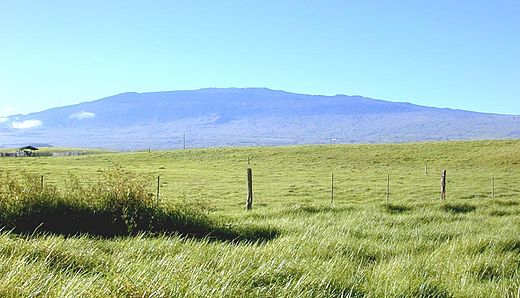 The dark outline of Hualalai, showing the worn and weathered shape of a volcano in the Post-shield stage. Hualalai from north.jpg