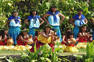 Hula - Hula kahiko performance at the pa hula in Hawaii Volcanoes National Park