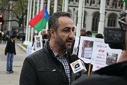 Hyrbyair Marri speaking to media in London during a protest.