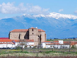 St John the Baptist´s church of Saucedilla, with the Sierra de Gredos snow-covered behind