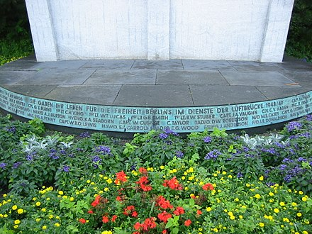 "Berlin Airlift Monument in Berlin-Tempelhof with inscription ""They gave their lives for the freedom of Berlin in service of the Berlin Airlift 1948/49"" InschriftLuftbruckendenkmal.JPG"