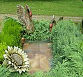 Interesting Grave - Two swans - Different View (1195642465).jpg