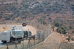 Israel Border Guard with water cannon.jpg