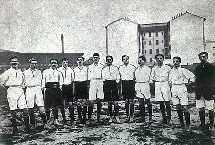 Italy in 1910, wearing the original white jersey. They would switch to the traditional blue shirt a year later. Italy national football team1910.jpg