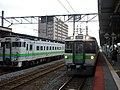 JR Hokkaido Kumoha 721-6 at Tomakomai Station.jpg