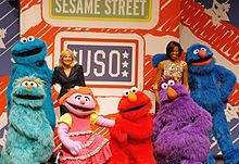 Jill Biden and Michelle Obama pose with some of the cast of Sesame Street, 2011.jpg