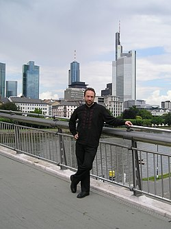 Jimmy Wales on the Holbeinsteg bridge in Frankfurt am Main, Germany, during a shooting break of a documentary film on Wikipedia created by French-German TV station arte