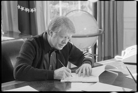 Carter in office, February 1977 Jimmy Carter working at his desk - NARA - 173610.jpg