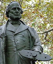 Photo of Statue of John Ericsson in the Battery, New York City, holding a model of Monitor in his hand