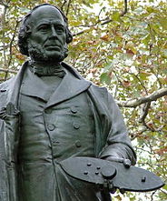 Photo of Statue of John Ericsson in Battery Park, New York City, holding a model of Monitor in his hand