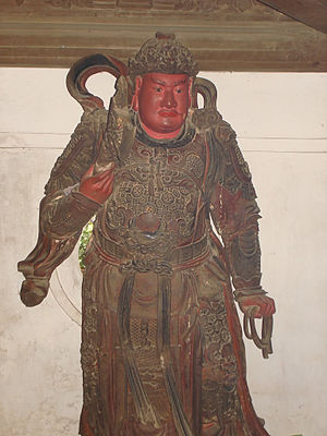 Vietnamese armour - Lacquered wood statue of a Guardian King of Buddhism, Tây Phương Temple, Hanoi.
