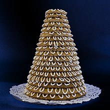 A pastry built out of 18 rings. Each ring is slightly smaller than the next, and they are stacked to form a tower