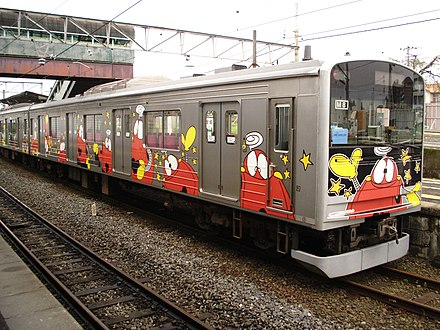 Robot characters from the Japanese science fiction television series Ganbare!! Robocon were used to decorate this train car. Kuha2053108.JPG