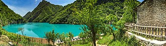 Lake Koman was formed as a result of the construction of the Koman Hydroelectric Power Station in 1985. Lake komani 2016 Albania.jpg