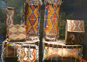 Parfleche - Parfleche is a type of container made from buffalo rawhide that Plains women  traditionally fashion into containers decorated with brightly colored geometrical designs.