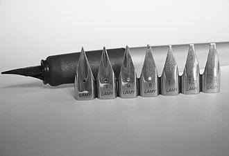 Lamy - Lamy Z 50 nibs in front of a Lamy Nexx fountain pen