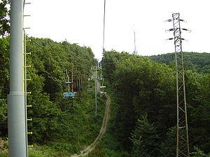 Bratislavský lesný park - A chairlift to Kamzík from the Vydrica valley, with the Kamzík TV Tower in the background