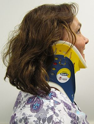 A side view of a person wearing a C spine collar.