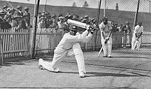 A cricketer hitting a ball