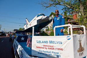 Leland D. Melvin - Image: Leland Melvin NASA Glenn Research Center Float 2010 Pro Football Hall of Fame Festival Timken Grand Parade