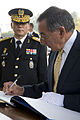 Leon Panetta signs his name to the book of visitors to the Seoul National Cemetery.jpg